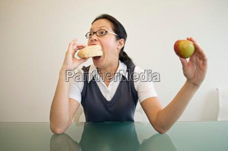 a business woman eating a sandwich
