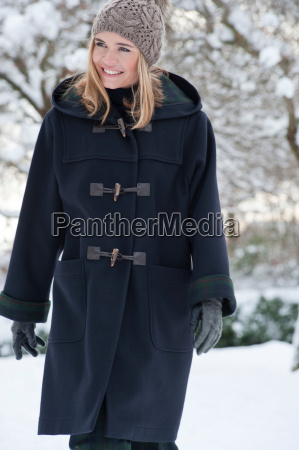 woman in heavy coat walking in