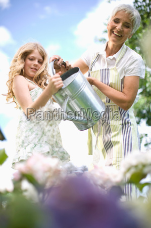 woman and girl in garden