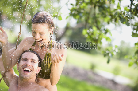man and woman in nature