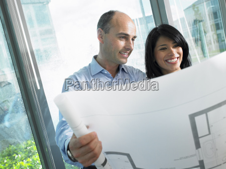 man and woman looking at blue