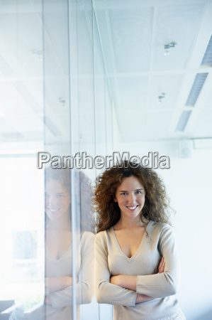 woman against window smiling