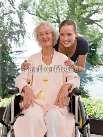 woman touching senior womans shoulders