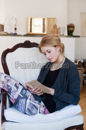 woman reading a book in living