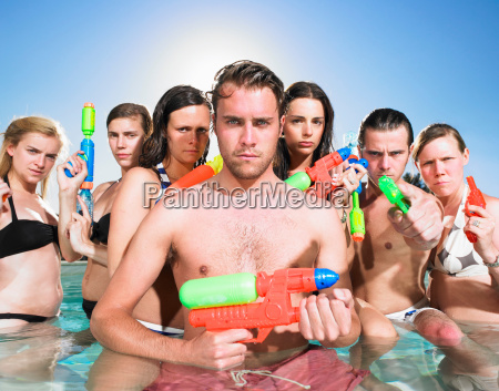 young people posing with water guns