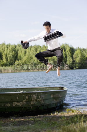 businessman jumping on rowboat