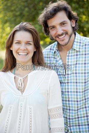 portrait of a couple smiling in