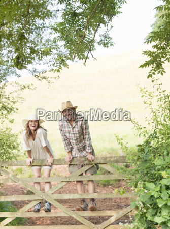 man and woman standing on country