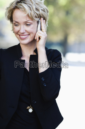 woman smiling using cell phone
