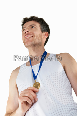 man in running gear wearing medal