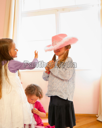 girls playing dress up together
