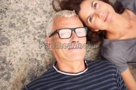 middle aged couple on rocks portrait