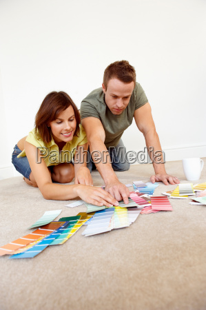 couple looking through colour samples