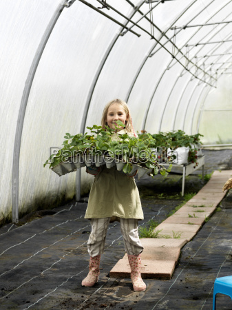 girl with green plants
