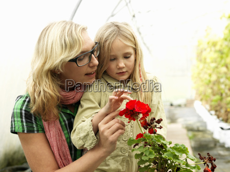 mother and daughter in green house