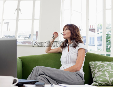 business women contemplating on sofa