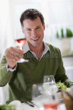 man enjoying a glass of wine