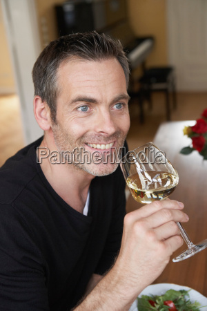 man, sipping, on, white, wine - 18314852
