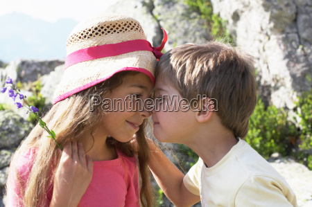 girl and boy touching noses