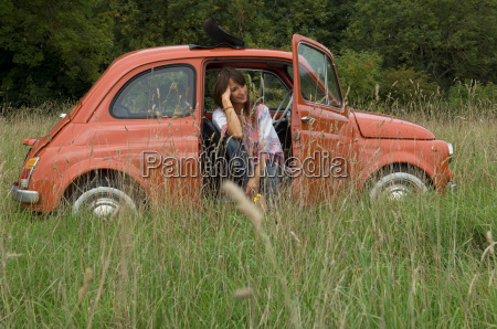 relaxed female sitting in car in