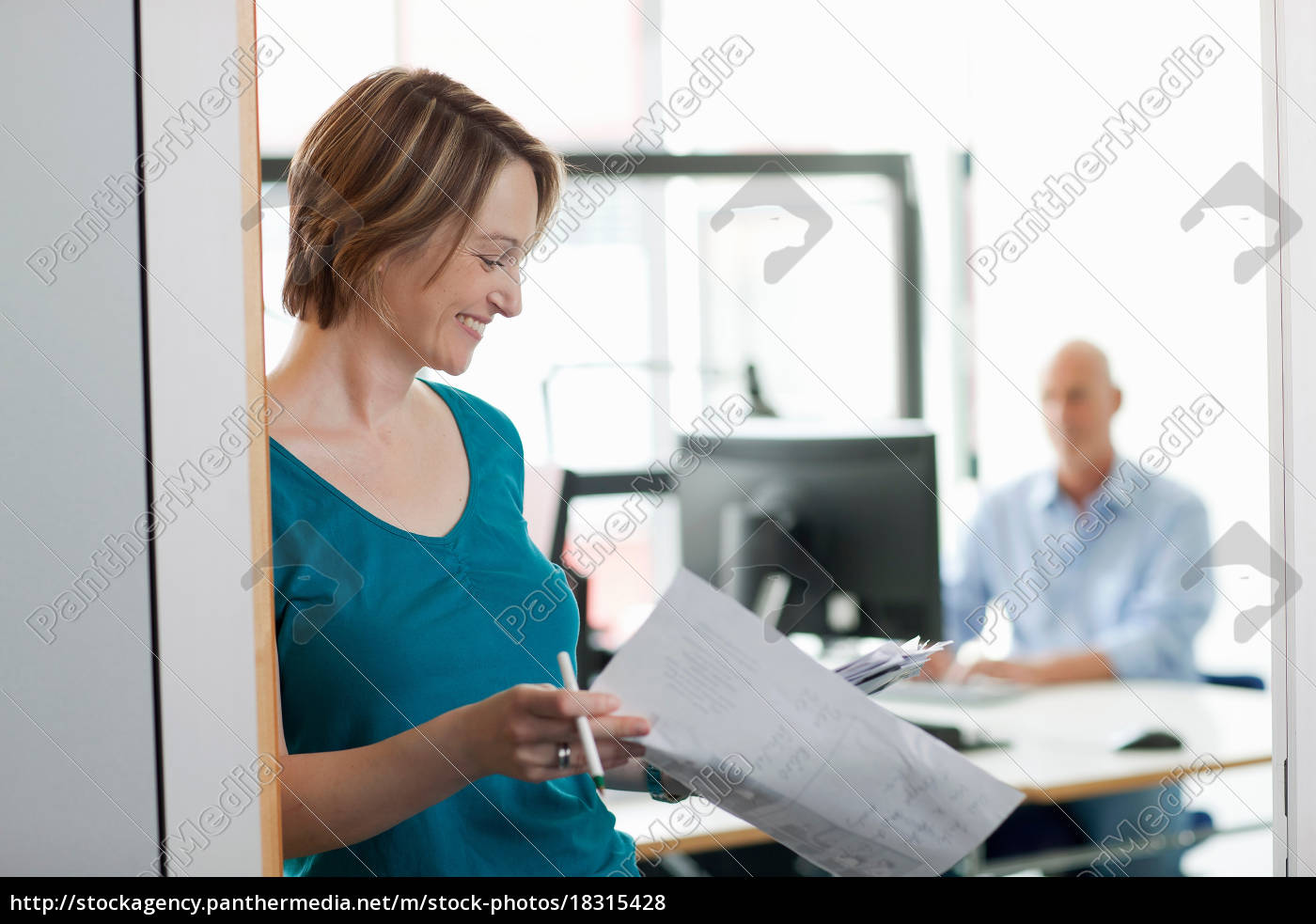 businesswoman, reading, papers, in, office - 18315428