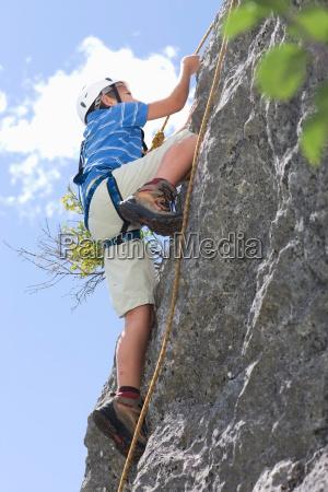 boy climbing up a hill
