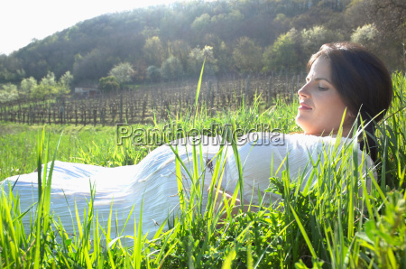 pregnant woman in long spring grass
