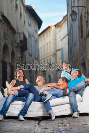 group look up sitting on couch