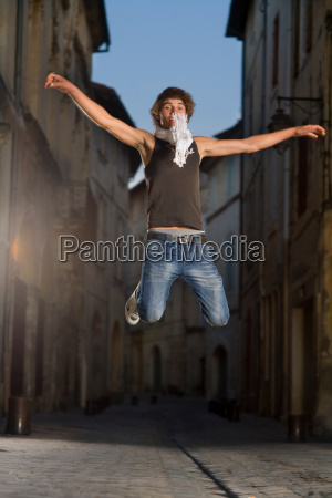 young man jumps in street at