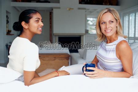 women having coffee in living room