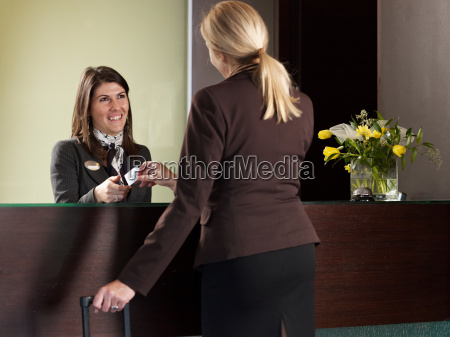 business woman paying for her hotel