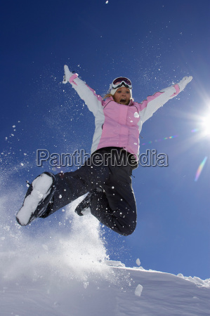 woman in ski boots playing in