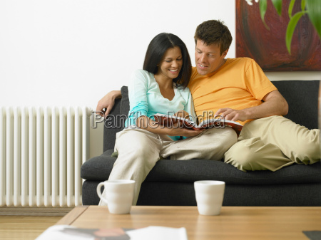 couple reading on couch together