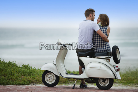 couple sitting on scooter together