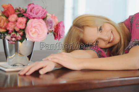 smiling woman laying on table