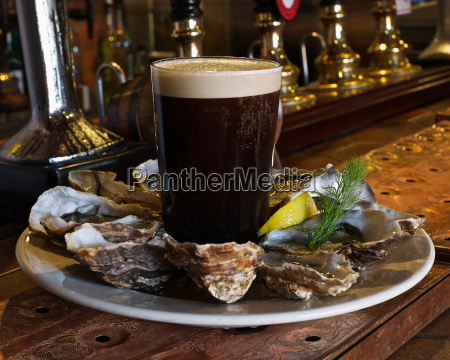 plate of oysters and stout in