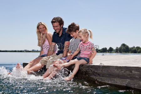 family playing together on dock