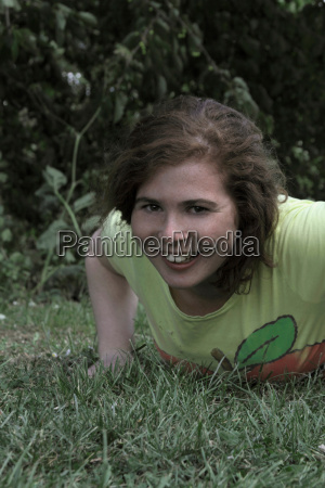 girl laying in grass at park