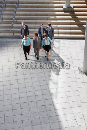 business people walking in courtyard