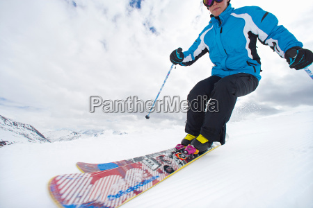 woman skiing on snowy mountainside