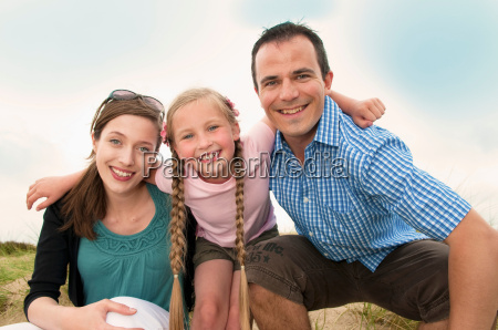 family smiling together outdoors