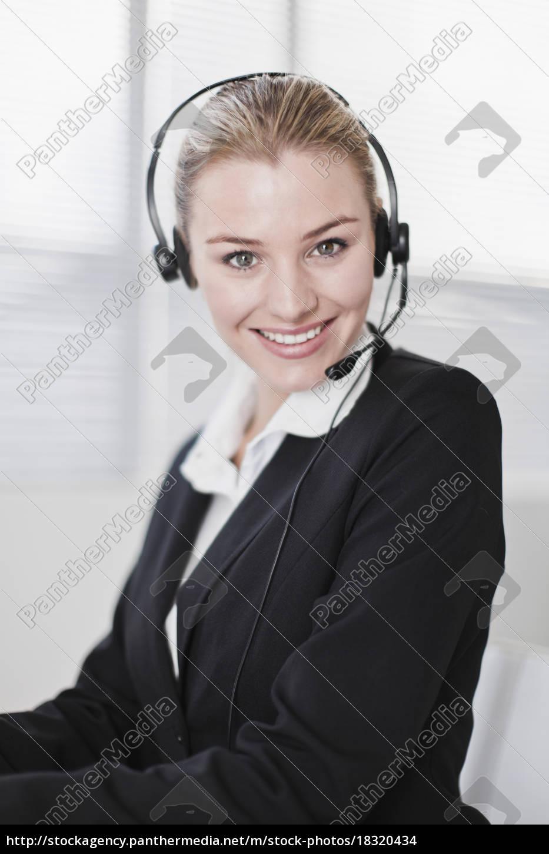 businesswoman, wearing, headset, in, office - 18320434