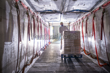 worker loading products into freezer truck