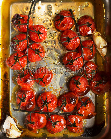 roasted vine tomatoes in roasting tin