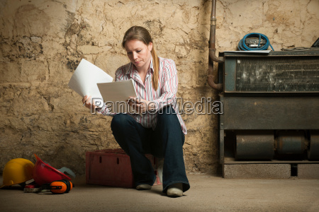 woman examining papers indoors