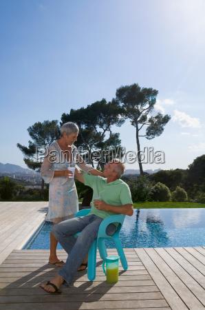 older couple hugging on terrace