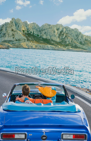 man and woman driving by coast