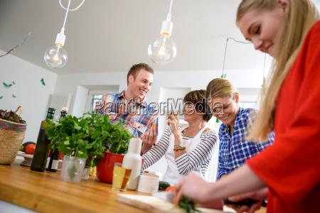mother with grown up children preparing