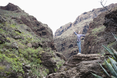 mid adult woman standing on cliff