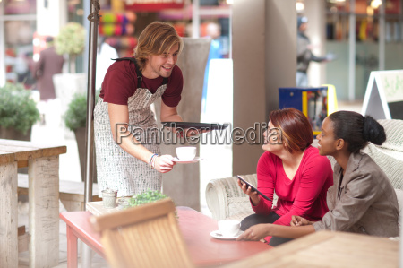 two female friends having coffee in